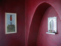hondo mirror on red walls
